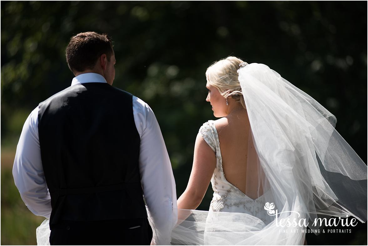 lake_lanier_wedding_summer_pictures_legacy_moments_family_candid_atlantas_best_wedding_photographer_tessa_marie_weddings_lake_lanier_bride_out_door_wedding_0139